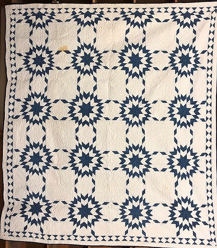 Lot 452: Blue & white multistar pattern quilt
