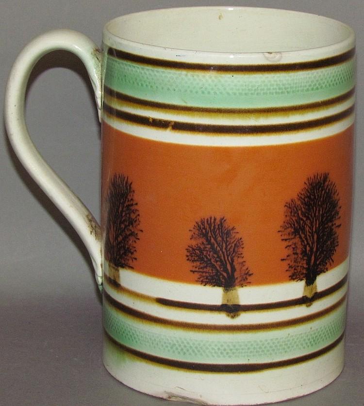 Lot 319: English Staffordshire creamware mocha mug