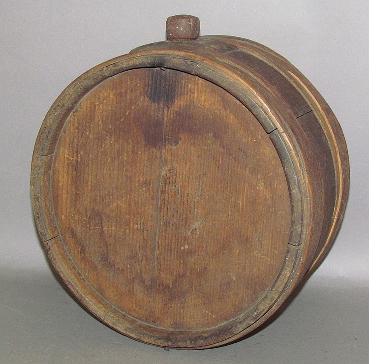 Lot 281: Wooden drum shaped canteen