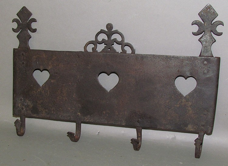 Lot 422: Sheet metal & wrought iron decorative utensil rack