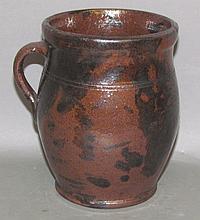 PA manganese decorated redware honey pot