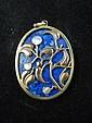 A yellow metal mounted lapis lazuli oval pendant,