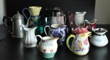 Grouping of 12 Pitchers & Teapots