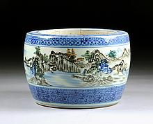 A CHINESE POLYCHROME ENAMELED PORCELAIN JARDINIÈRE, 20TH CENTURY,