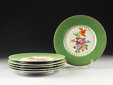 A SET OF SIX BOHEMIAN GREEN GROUND AND FLORAL DECORATED PLATES, RED