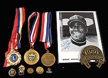 Lot of Minnie Minoso pins and presentational medallions.