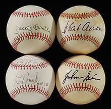 Mickey Mantle, Hank Aaron, Lou Brock, and Johnny Sain autographed baseballs.