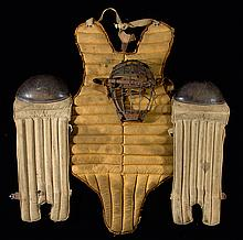 Lot of vintage baseball catcher's equipment to include: Reach spider style mask, pair of reeded canvas shin guards, and Spalding chest protector.