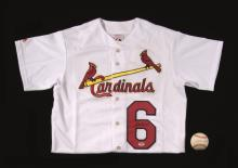 Stan Musial autographed St. Louis Cardinals jersey and single signed baseball. Home white Cardinals jersey signed across the front by Musial in black sharpie (blank back): NM. Stan Musial single signed baseball inscribed