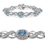 Diamond White:Round/1.30mm 12/0.13mm + Topaz Blue:Oval/6x4mm 8/5.20 ctw #28972v3
