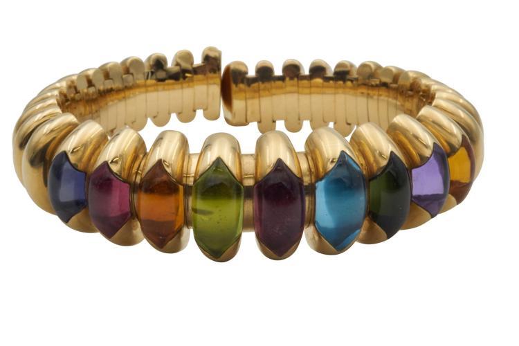 BULGARI Bracelet en or jaune 750, serti de 9 pierres de couleurs . Avec son coffret Poids total 97,6 g Avec attestation pour valeur assurance à CHF 14'000.-18k yellow and pink 9 gems bracelet with box