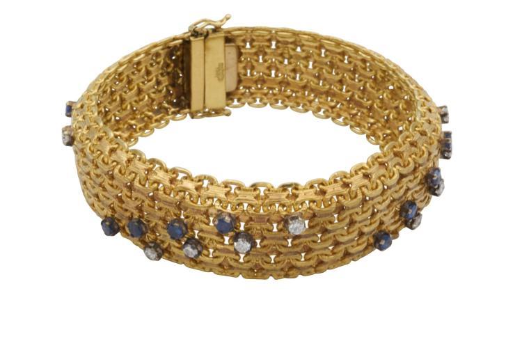 Bracelet en or jaune 750, serti de 16 diamants représentant 0.96 carat et 16 saphirs représentant 1.9 carat. Signé RATTA Poids total 71,5 gr Longueur 20 cm