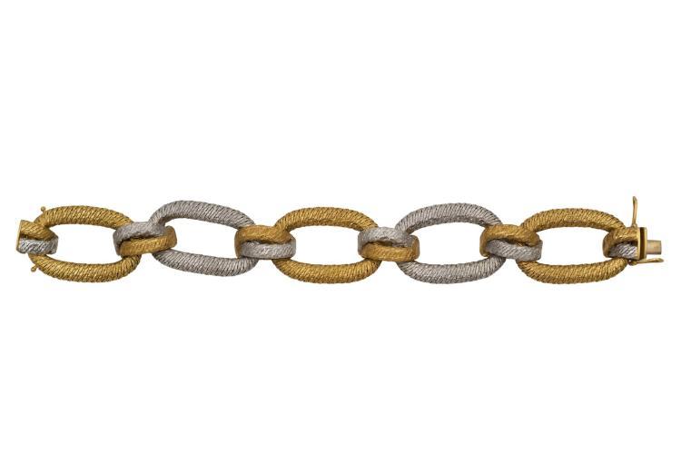 Bracelet en or bicolore 750, 5maillons, 3 jaunes 2 gris Longueur 20 cm Poids total 104 gr Avec attestation pour valeur d'assurance à CHF 18'700.-