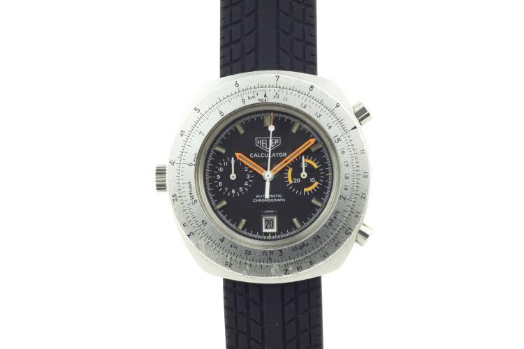 Montre HEUER Calculator en acier , automatique chronographe avec règle de calcul, , calibre 12, remontage à gauche, bracelet caoutchouc, années 1970 Diamètre 46 mm A stainless steel chronograph men's wristwatch