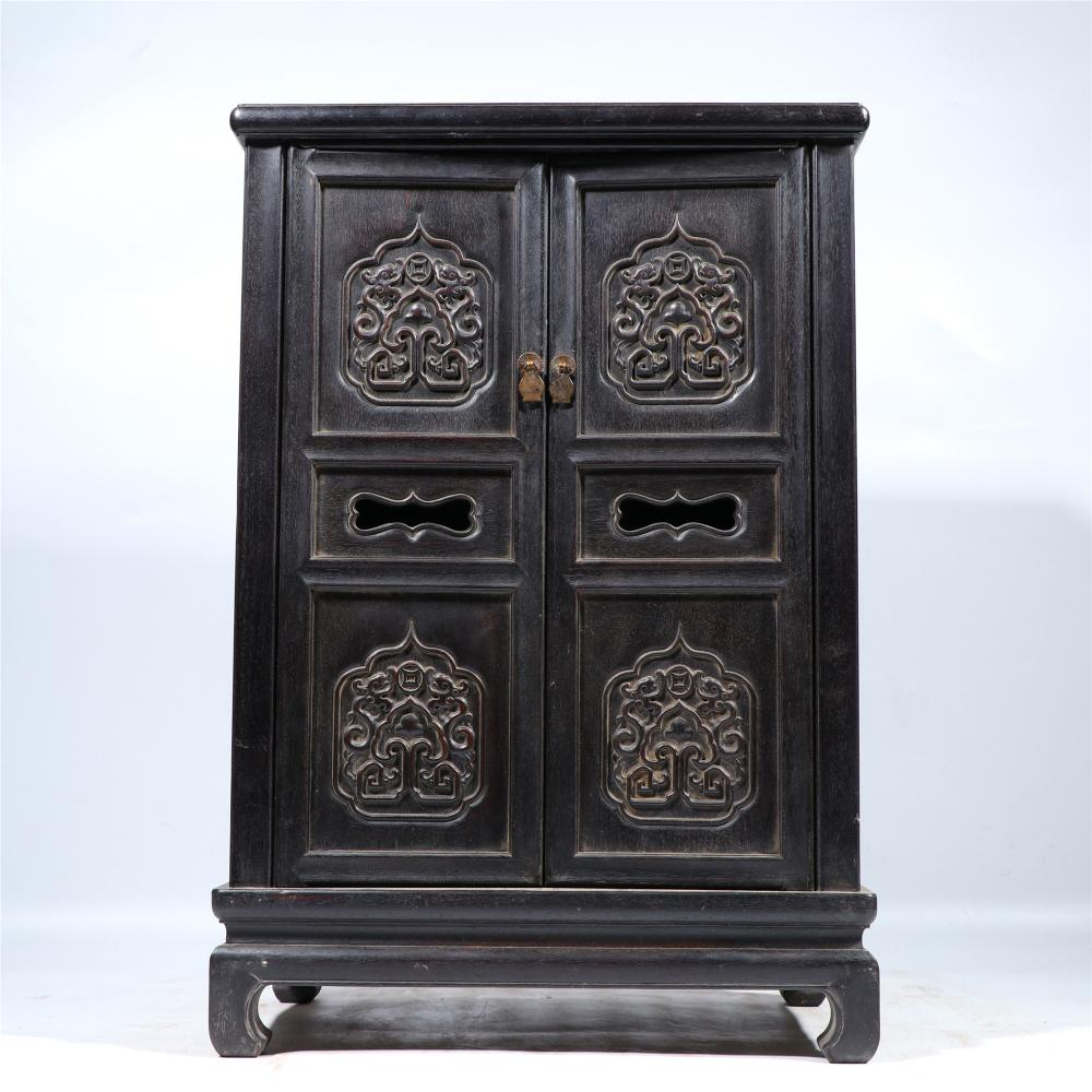 A CARVED ROSEWOOD CABINET