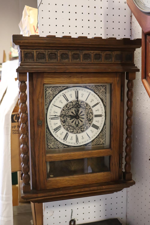 An oak cased key-wind wall clock