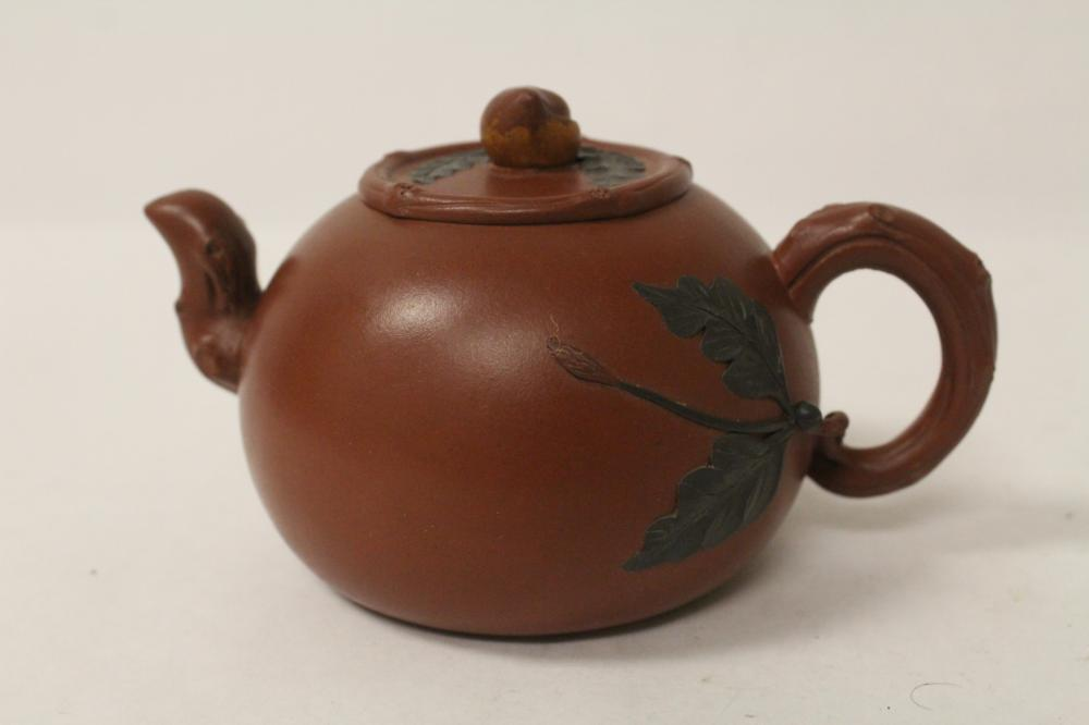Chinese Yixing teapot with color overlay