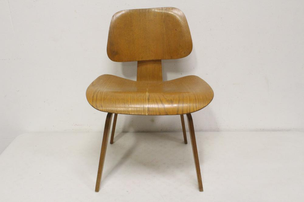 An early Charles Eames molded plywood DCW chair