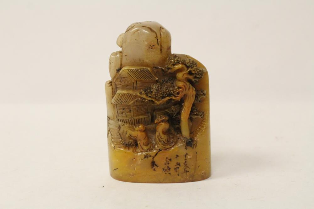 An elaborately carved shoushan stone seal