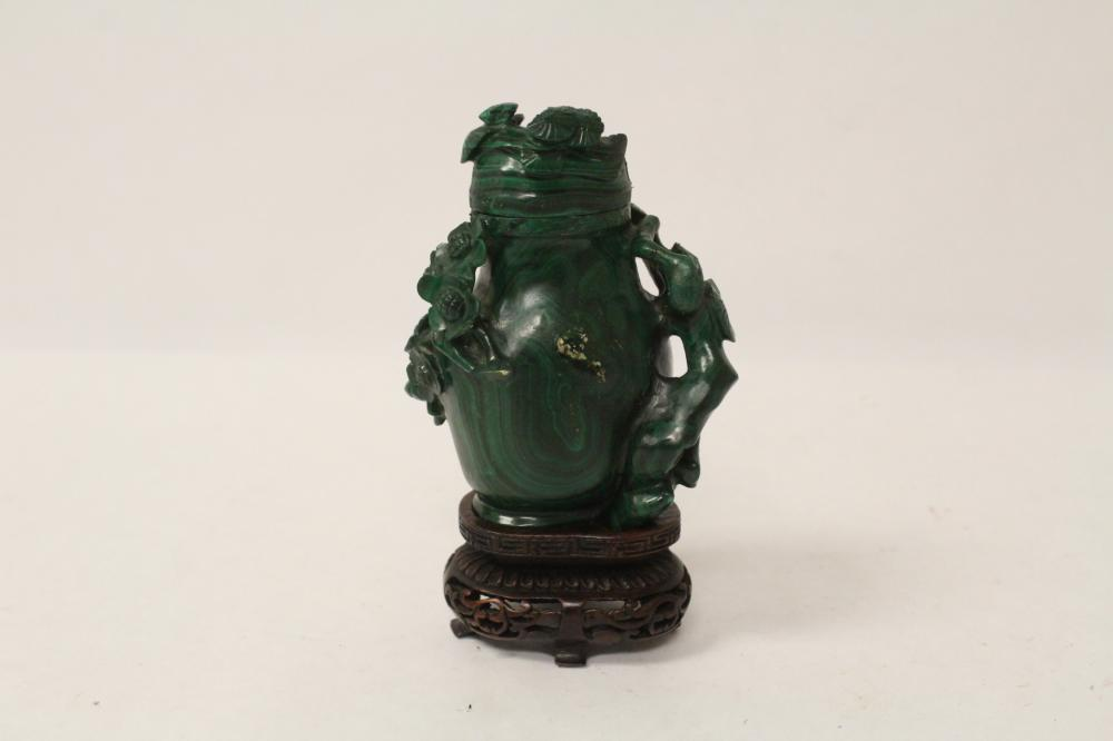 A small malachite carved vase