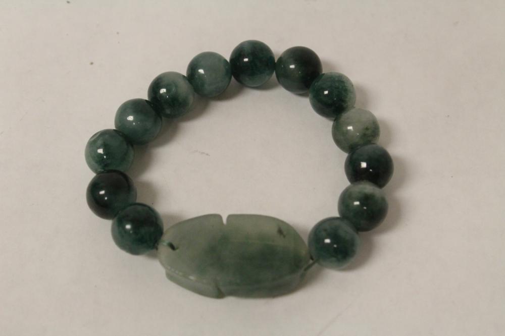 A fine translucent apple green jadeite bracelet