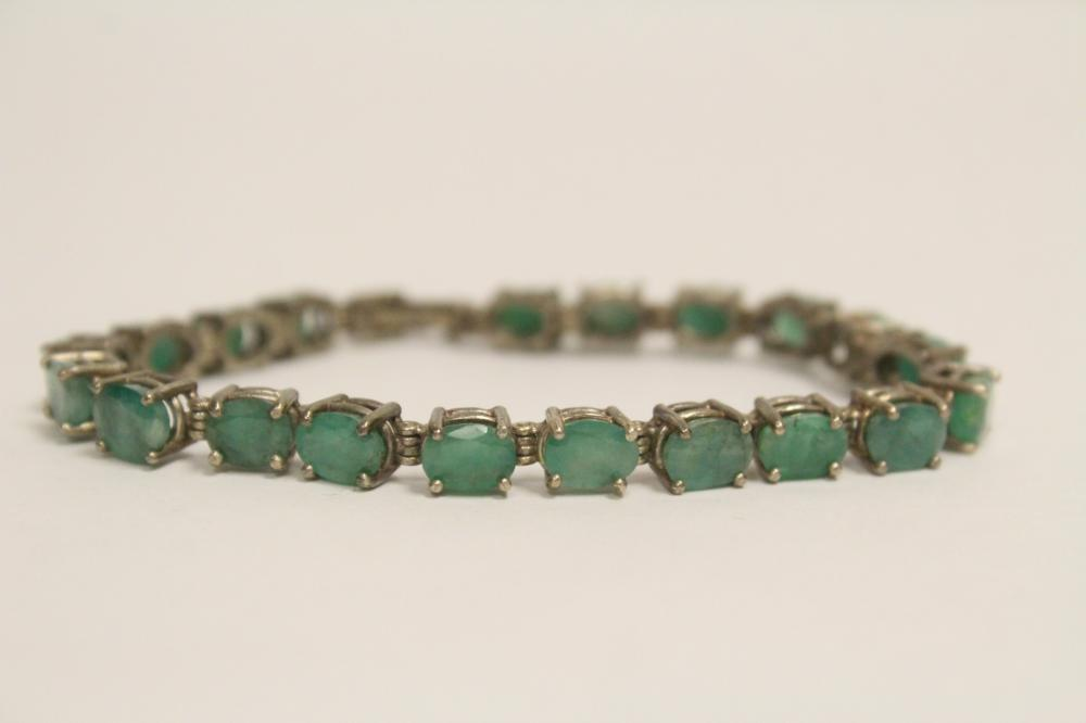 Sterling silver bracelet set with genuine emerald