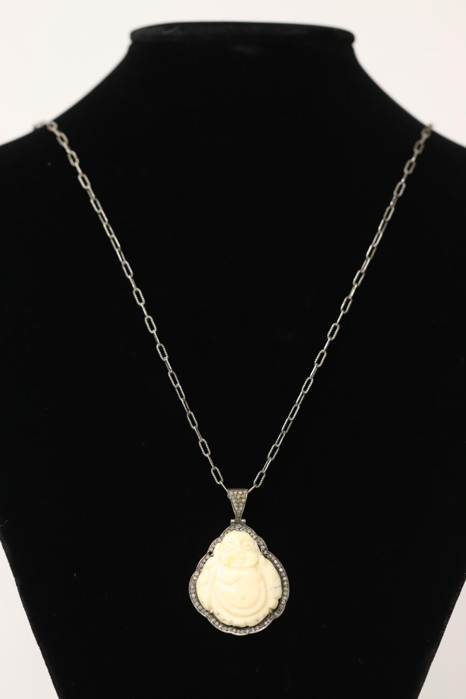 Sterling pendant w/ diamonds & a sterling necklace