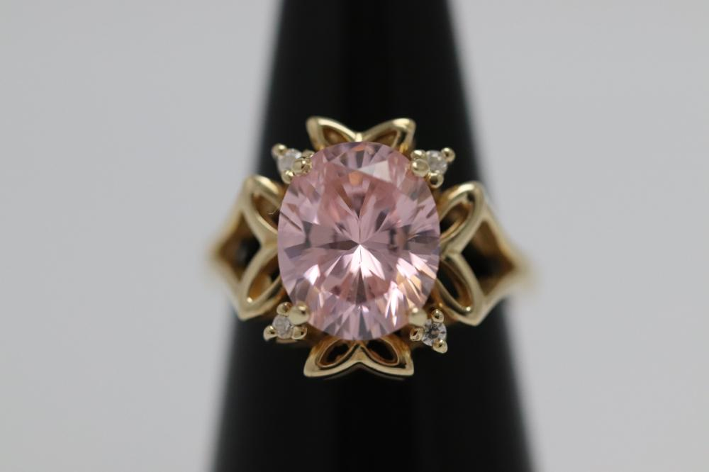 A 14K ring, center a pink stone, wt. 5.9gm, size 5.5