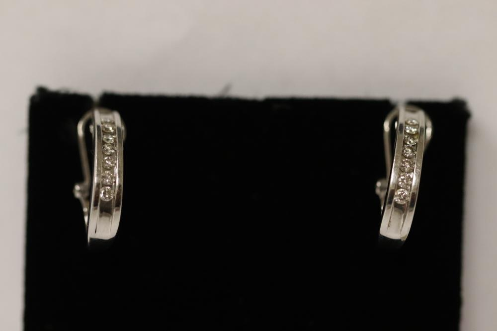 Pair 14K W/G diamond earrings