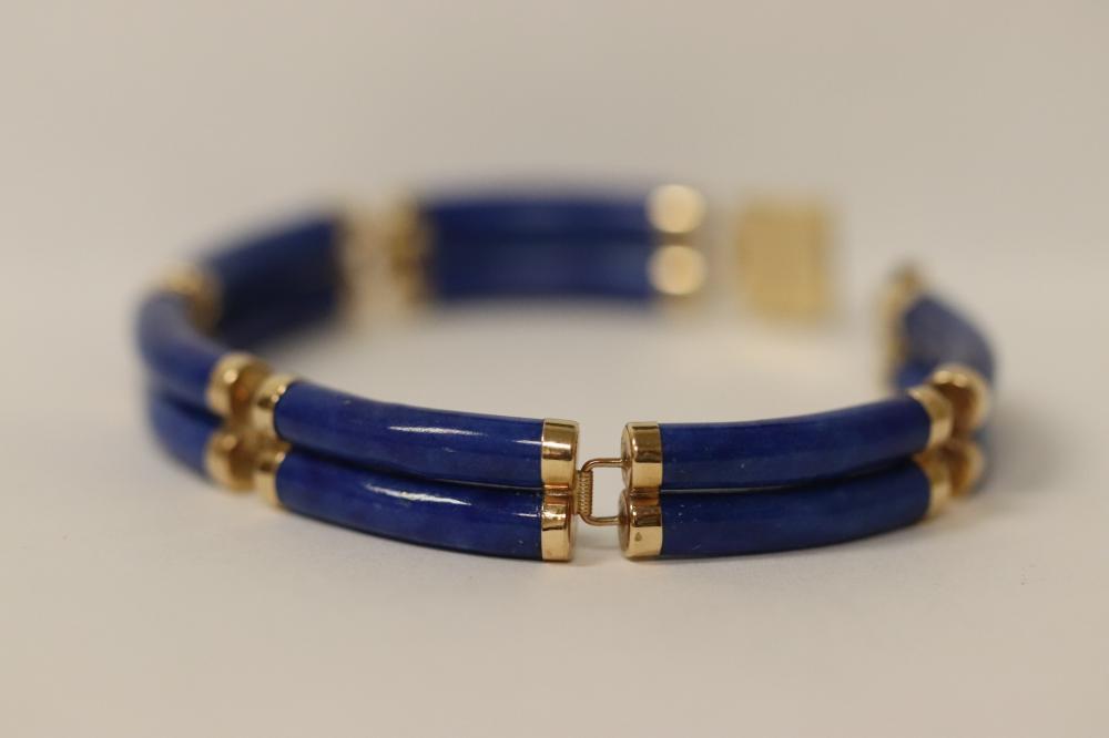 14K Y/G bracelet w/ gem quality intense blue lapis