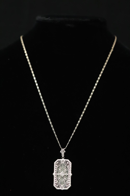 A filigree 14K pendant w/ diamond & 14K necklace