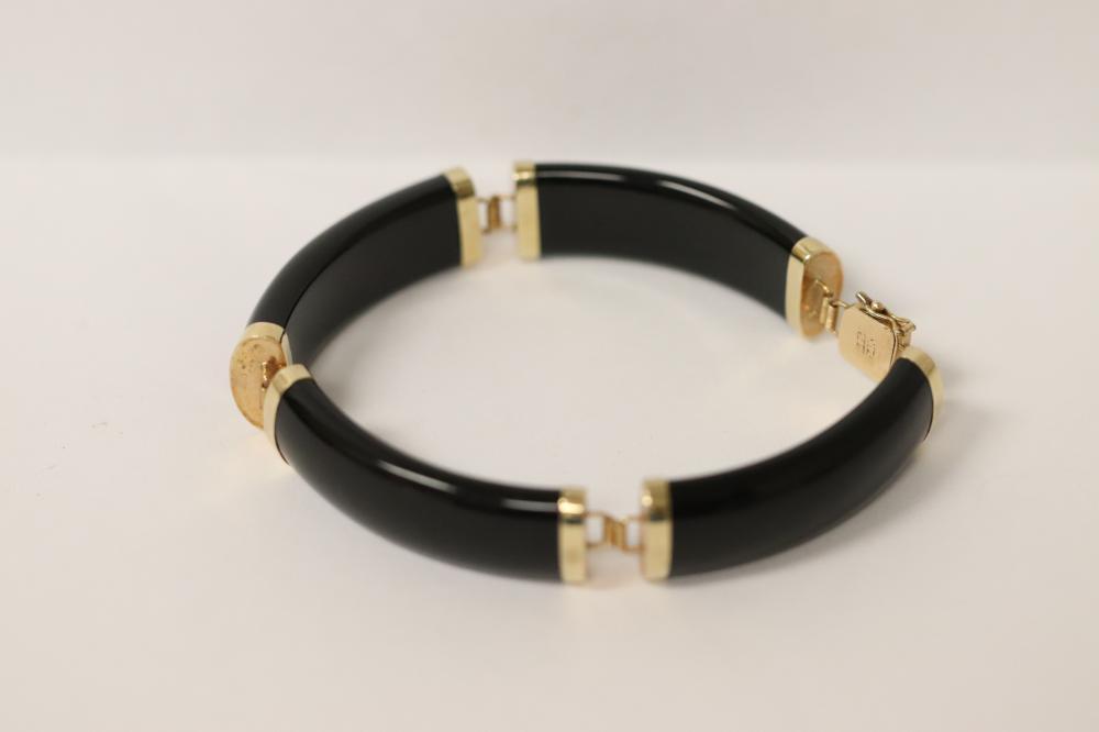 A fine vintage 14K rose gold bracelet with onyx
