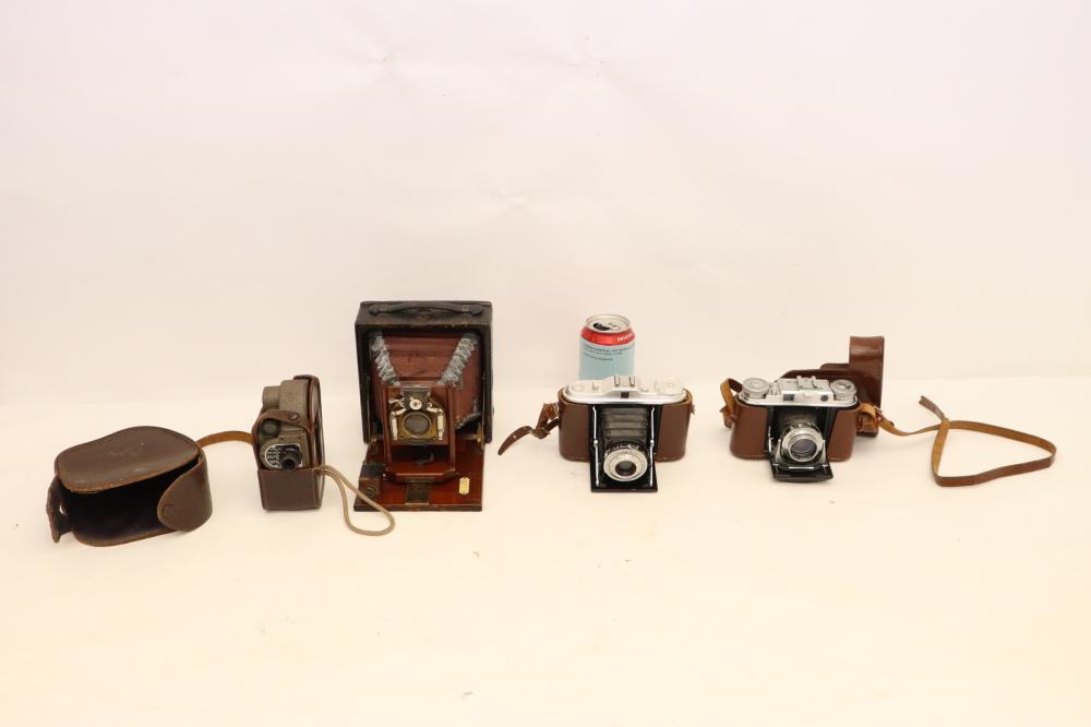 3 vintage cameras and a vintage movie camera