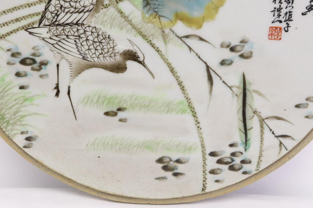2 Chinese famille rose round porcelain plaques
