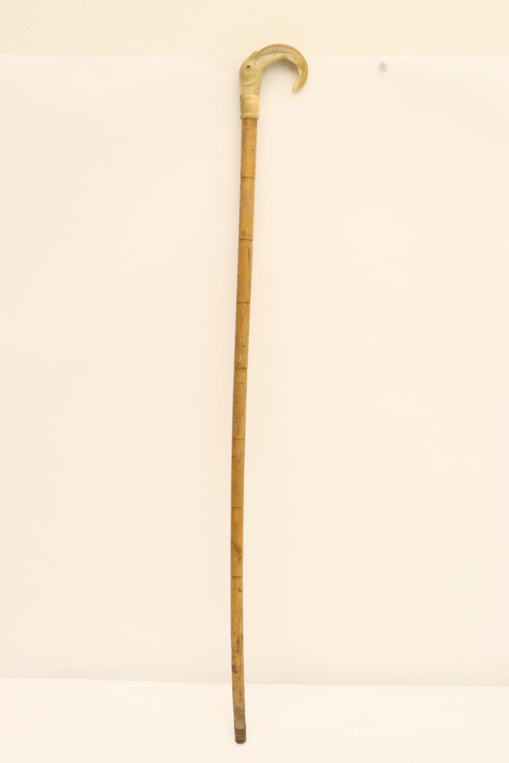 antique cane with horn carved top in bird motif