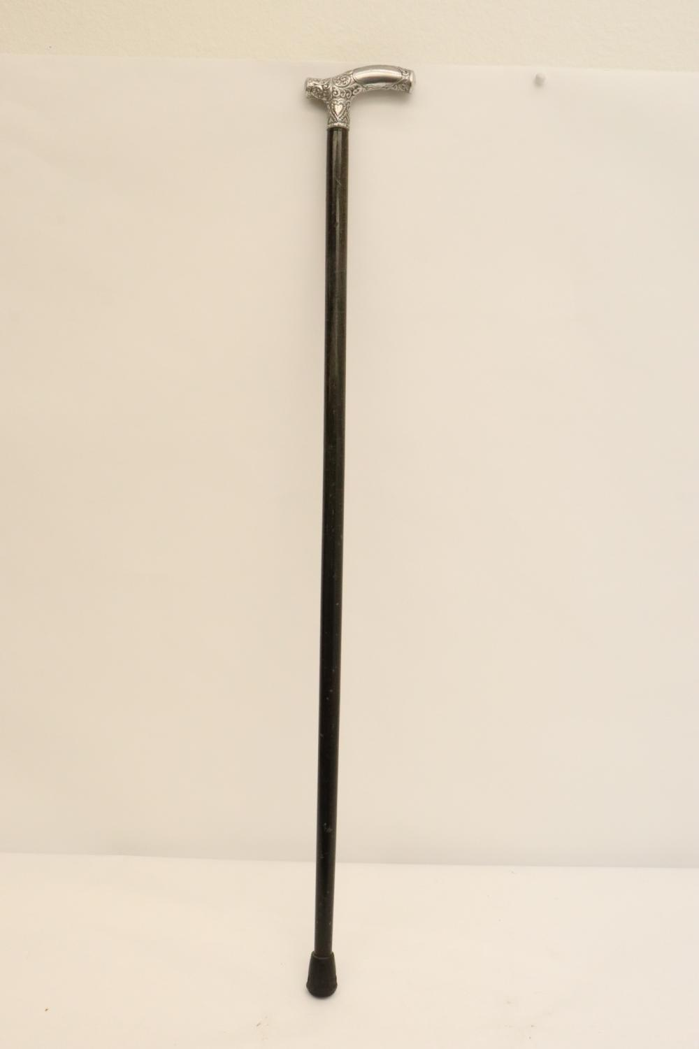 Antique cane with ornate silver top