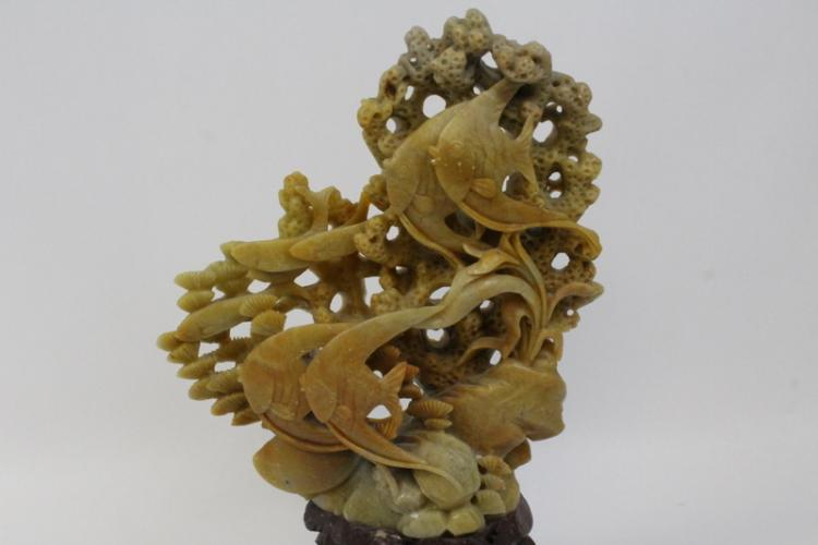 A soap stone carving an antique japanese kutani vase