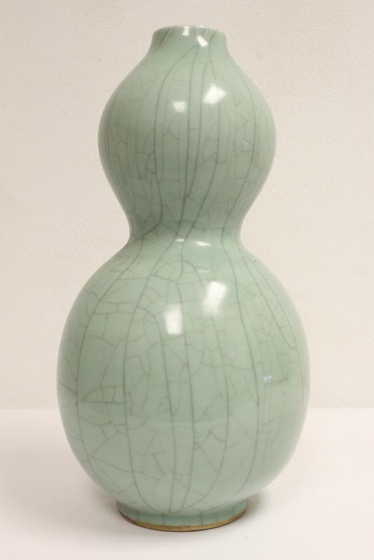 Large Chinese celadon gourd shape vase, drilled