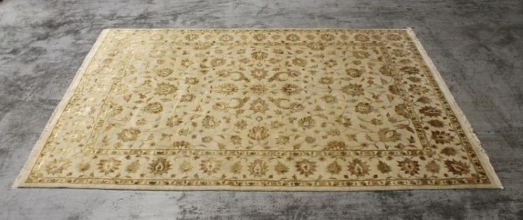 A room size India silk rug decorated with flowers