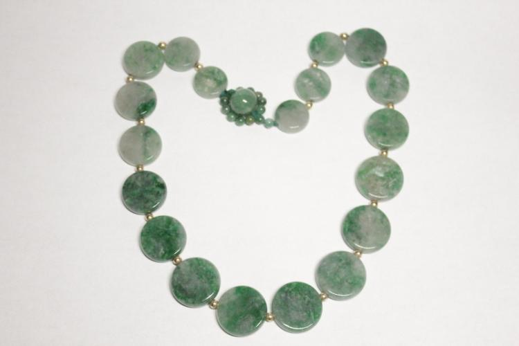 Necklace with round jadeite plaques