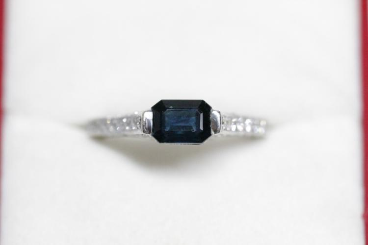 A beautiful 18K W/G sapphire diamond ring