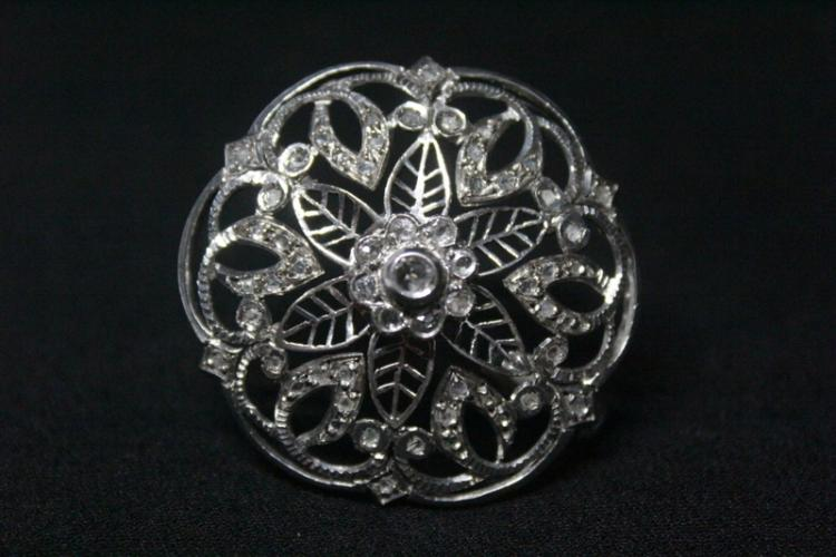 Silver circular diamond brooch