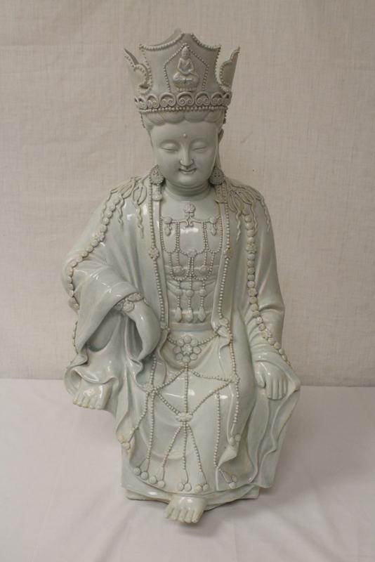 A large Chinese yingqing style porcelain Buddha