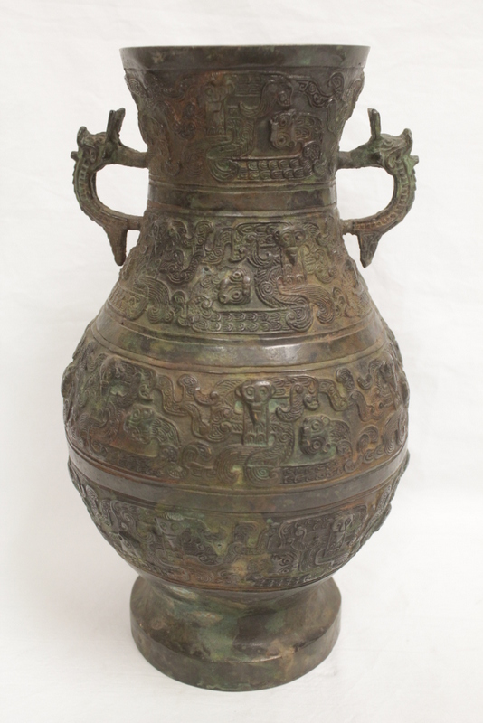 Chinese archaic style bronze handled wine vessel