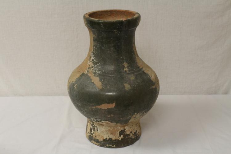 A large Chinese Han style green glazed pottery vase