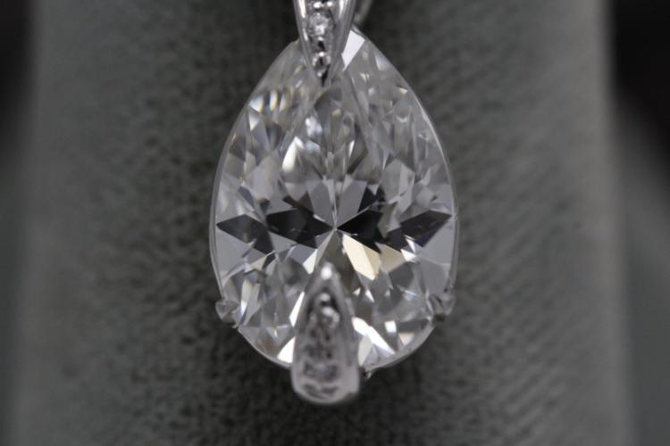 An important 14K W/G diamond pendant