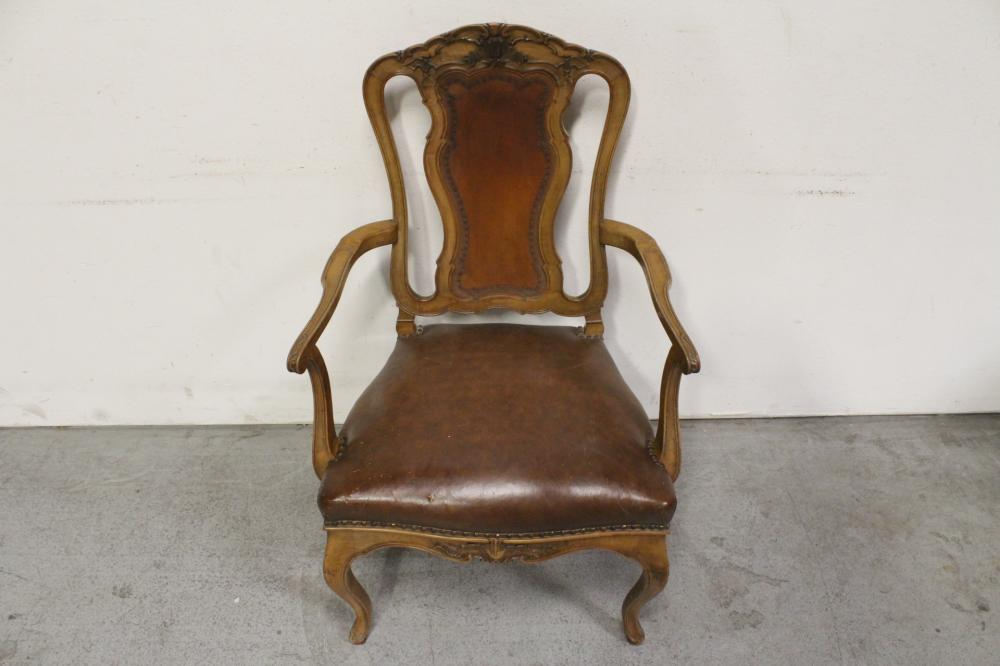 Lot 78: Victorian walnut armchair w/ leather upholstery
