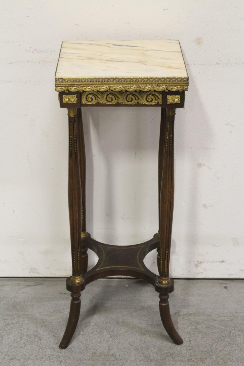 Lot 77: Marble top stand with gilt metal ormolu