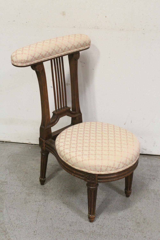 Lot 79: Victorian walnut slipper chair