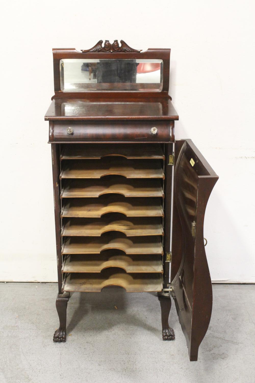 Lot 81: Mahogany musical cabinet w/ beveled mirror top